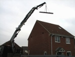 steel RSJ being lifted over house